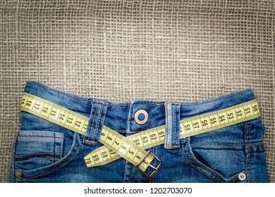 Jeans and measuring subject for weight loss