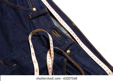 Jeans and measuring tape -  isolated on white background