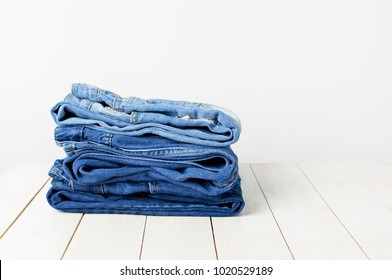 Jeans on a light background. Detail of nice blue jeans. Jeans texture or denim background.
