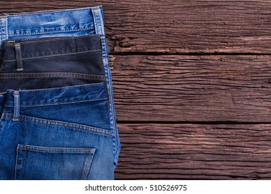 Jeans on the old wooden floor. for design denim fashion. Retro style