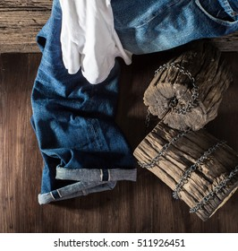 Jeans on the old wooden floor. for design denim fashion. Retro style. Horizontal hip adapter.