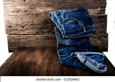 Jeans on the old wooden floor. for design denim fashion. Retro style. Horizontal hip adapter.Isolated white background