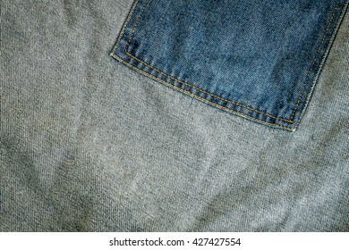 Jeans on a wooden floor Customize the colors dark tone .Meaning rock and roll style