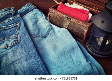 jeans on a wooden table near the lamp