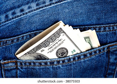 Jeans pocket with many one hundred dollars banknotes