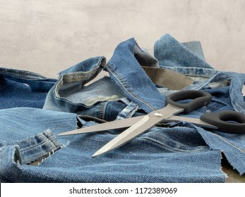Jeans, ready to be recycled. Scraps of old discarded jeans can start a new life. Circular economy, reduce, reuse recycle.