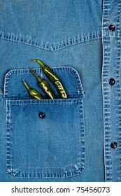 Jeans shirt pocket with green pepper