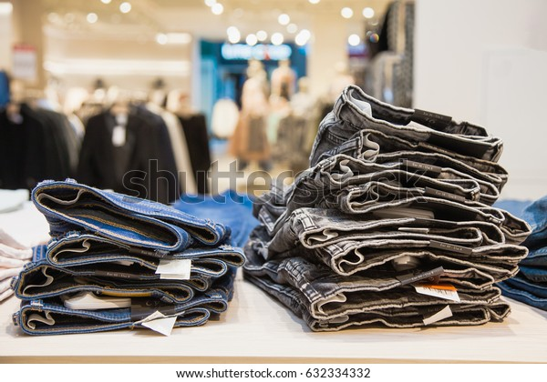 Jeans at shop. Shopping concept. Denim outfit on store shelf