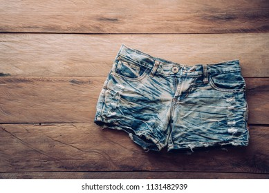 Jeans shorts on the wooden floor.