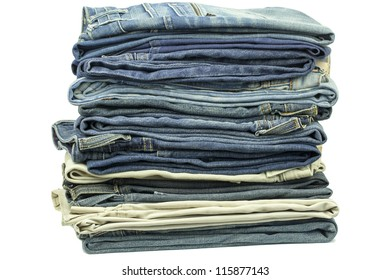 Jeans stacked together on a white background