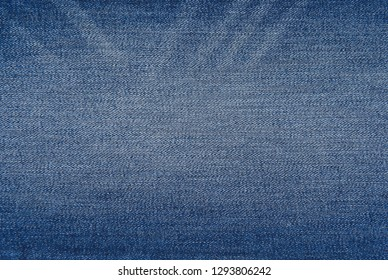 Jeans texture background - jean pants fabric of blue washed denim textile.