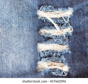 Jeans torn denim texture.