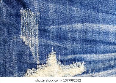 Jeans torn denim texture background.