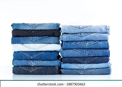 Jeans trousers stack on white background.back pocket of jeans concept.