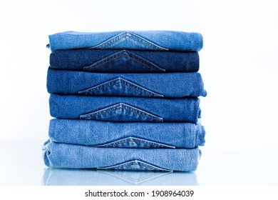 Jeans trousers stack on white background.concept  jean in supermarket.