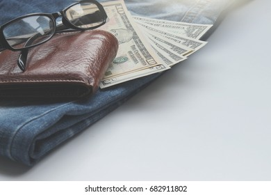 Jeans, wallets, dollar, glasses for the financial and tourism background.