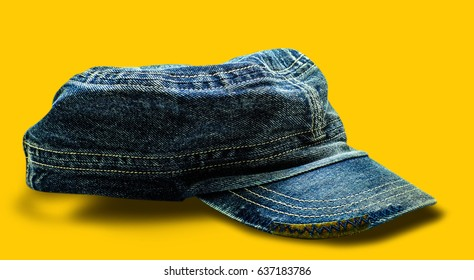 jeans working peaked cap. Isolated on a yellow background.(clipping part)
