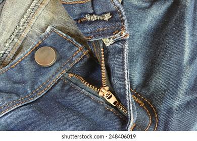 Jeans zipper open.