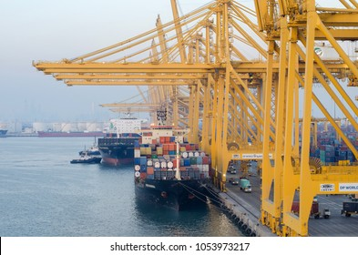 Jebel Ali, United Arab Emirates - March 16: Container vessels in port of Jebel Ali on March 16, 2018 in Jebel Ali, United Arab Emirates.