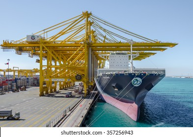 Jebel Ali, United Arab Emirates - December 13:  Container vessel in port of Jebel Ali on December 13, 2015  in Jebel Ali, United Arab Emirates.