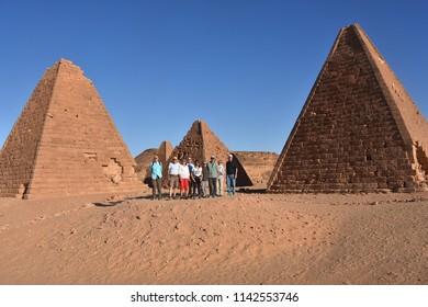 Jebel Barkal, Sudan - November, 22, 2017: Group of tourists under pyramids