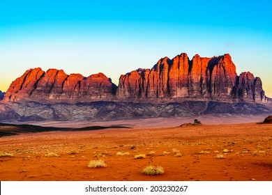 Jebel Qatar Mountain in Wadi Rum, Jordan at early-morning. Wadi Rum is known as The Valley of the Moon and has led to its designation as a UNESCO World Heritage Site.