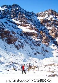 Jebel Toubkal. A lone climber ascending the Tizi n Toubkal to the summit of Jebel Toubkal in the Atlas mountains, Morocco.