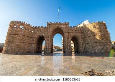 Jeddah, KSA - December 7th 2019: Exterior view of the masoned Makkah Gate or Baab Makkah (Bab Makkah), an old city gate at the entrance to the historic town (Al Balad) of Jeddah, Saudi Arabia