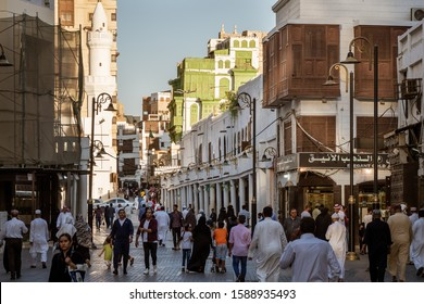 Jeddah, KSA - December 7th 2019: View of the Souk al Alawi Street, the greenish Noorwali coral town house and the Al Ma'amar Mosque at the historic district Al Balad in Jeddah, KSA