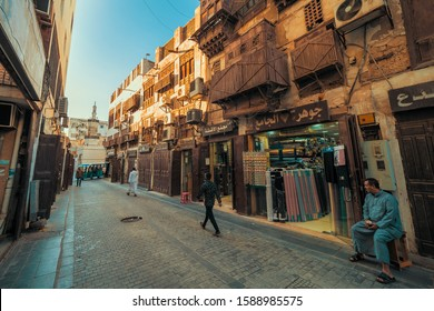 Jeddah, KSA - December 7th 2019: View of a narrow street with old coral town houses at the historic district Al Balad in Jeddah, KSA, Saudi Arabia