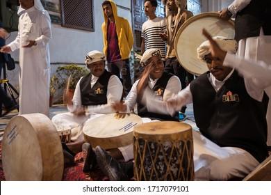Jeddah / Saudi Arabia - January 16, 2020: arab and saudi men celebrate a tradicional dance with music in the streets of Al-Balad historic downtown