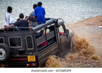 Jeep driving through deep water on safari in Minneriya National Park, Sri Lanka taken on 16 September 2016