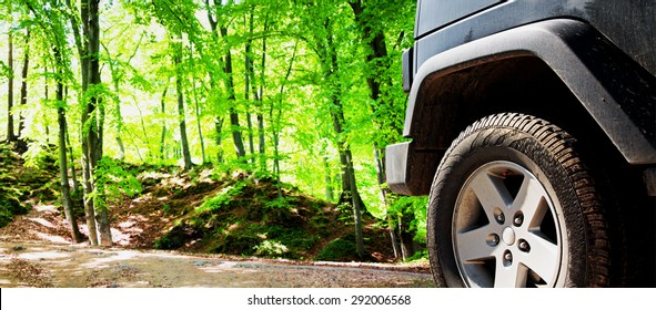 Jeep suv car wheel on offroad dirt adventure trail