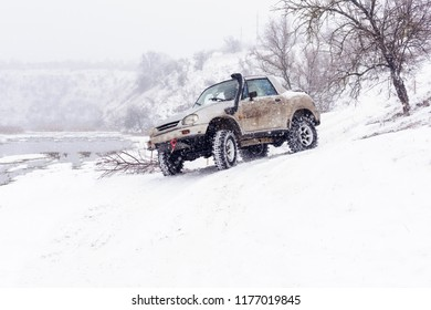 Jeeps compeating in winter rally competition with mud and snow. Magdacesti, Moldova