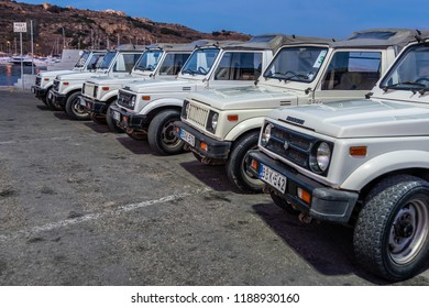 A lot of jeeps parked on the road. Malta.  Mgarr hourbour. safari tour around Gozo.  September 2018 Mgarr Malta.