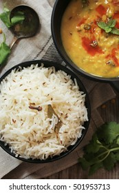 Jeera Rice with Dal tadka -Indian  Cumin rice with lentil curry overhead view