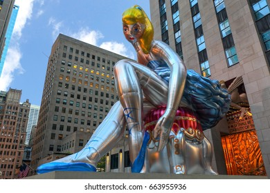 Jeff Koons's inflated 'Seated Ballerina' sculpture in Rockefeller Plaza in New York City on a bright, cloudy day.