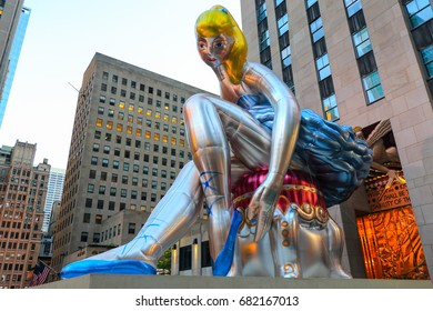 Jeff Koons's inflated 'Seated Ballerina' sculpture in Rockefeller Plaza in New York City at sunset
