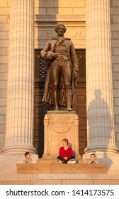 Jefferson City, MO - 1/7/2008: A mother with two children sitting at the base of Thomas Jefferson statue in front of Missouri state capitol building in jefferson city.