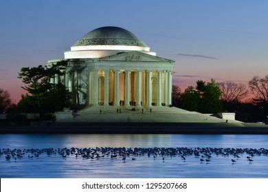 Jefferson Memorial at night with frozen lake and seagulls