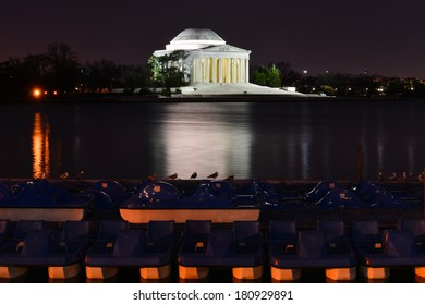 Jefferson Memorial at night with mirror reflection on water, Washington DC United States
