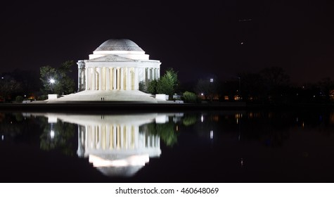 The Jefferson Memorial reflects in the Tidal Basin
