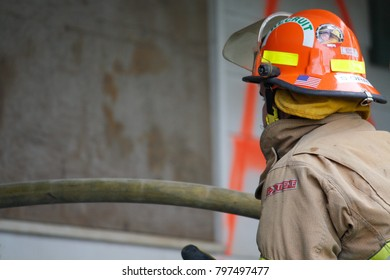 Jefferson, Oregon/ USA-05-05-2011  Fire fighter looking in the building