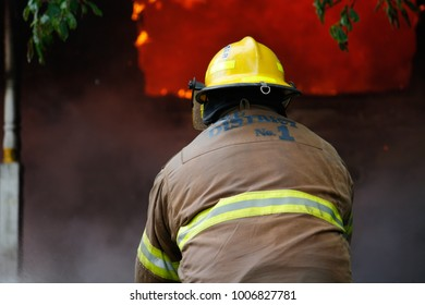 Jefferson, Oregon/USA - 05-05-2012  Fire fighter moving toward the flames