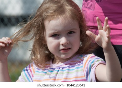 Jefferson, Oregon/USA - 07-04-2010  Close up of little girl waving at the parade