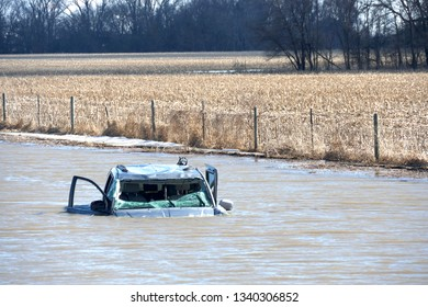 Jefferson, South Dakota / United States - March 16 2019: Abandoned vehicle completely submerged in water next to South Dakota I-29 highway after record flooding.