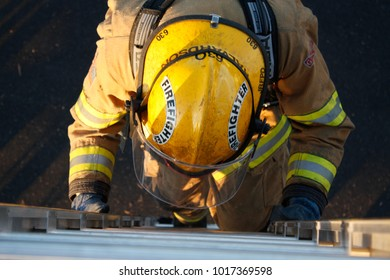 Jefferson/Oregon/USA - 09-22-12 Close up of fire fighter starting up the ladder