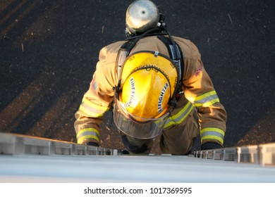 Jefferson/Oregon/USA - 09-22-12 Fire fighter just coming up the ladder