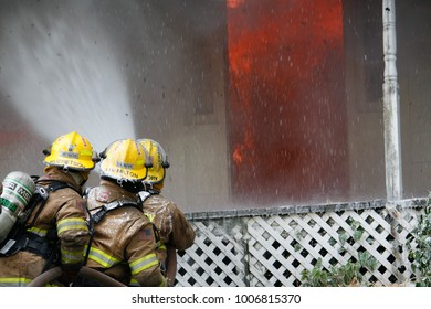Jefferson,Oregon/USA-05-05-2012  Fire fighters spraying the left side of the burning house