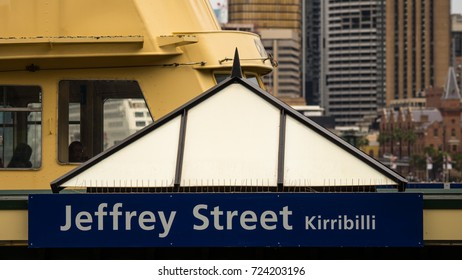 Jeffrey Street Ferry Wharf, with departing ferry and city background, Sydney, Australia
